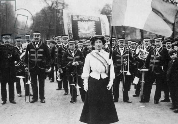 SUFFRAGETTE PARADE, 1908 Daisy Dugdale bears the standard in a procession at London, 22 December 1908, celebrating the release of Emmeline and Christabel Pankhurst from Holloway Gaol.