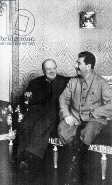 CONFERENCE, 1942 British Prime Minister Winston Churchill with Soviet leader Joseph Stalin at Moscow, Soviet Union, during World War II, August 1942.