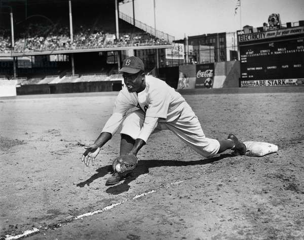JACKIE ROBINSON (1919-1972) John Roosevelt Robinson, known as Jackie. American baseball player. Playing first base for the Brooklyn Dodgers at Ebbets Field, Brooklyn, probably 1947.