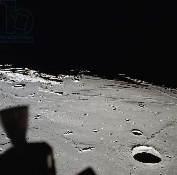 APOLLO 11: MOON, 1969 The approach to Apollo Landing Site 2 as seen from the Apollo 11 Lunar Module in lunar orbit. Photograph, 20 July 1969.