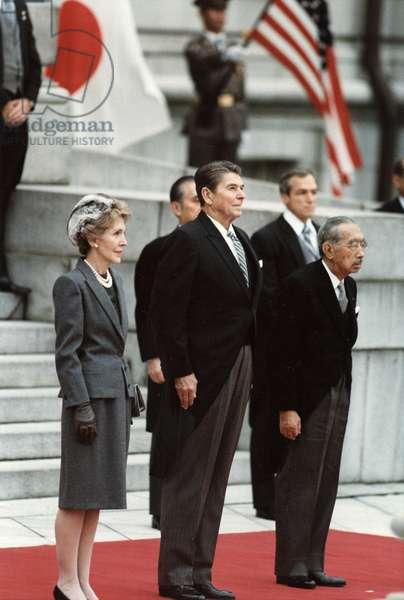 REAGANS AND HIROHITO, 1983 First Lady Nancy Reagan, President Ronald Reagan and Emperor Hirohito in Tokyo, Japan. Photograph, 9 November 1983.