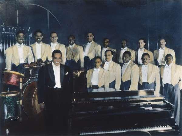 DUKE ELLINGTON (1899-1974) Duke Ellington with his orchestra. Oil over a photograph, 1937.