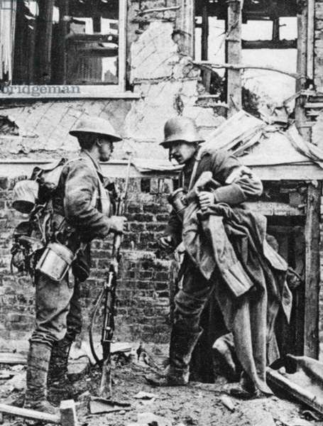 WORLD WAR I: SURRENDER German soldier emerging from a cellar to surrender to the British troops during World War I. Photograph, c.1917.