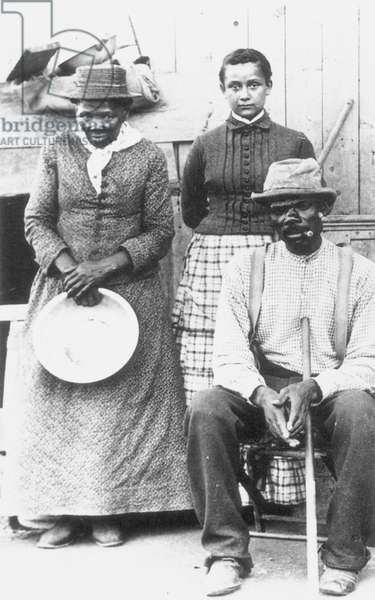 HARRIET TUBMAN ( c.1823-1913) American abolitionist. Photographed with a group of former slaves, late 19th century.