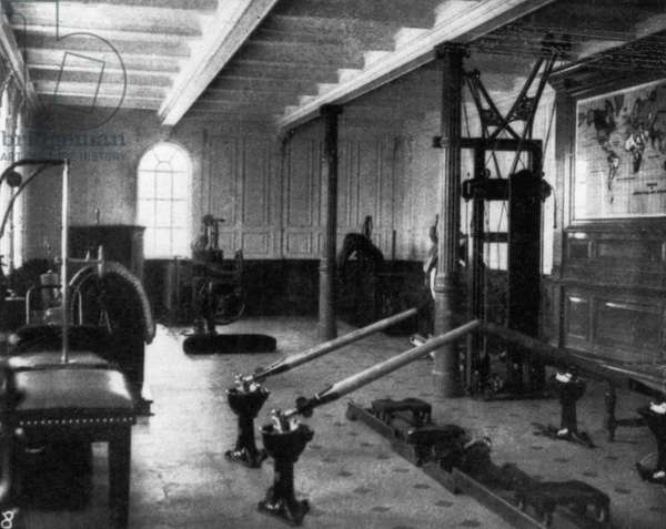 "TITANIC: EXERCISE ROOM, 1912 The gymnasium aboard the ""Titanic,"" showing the various exercise equipment, 1912."