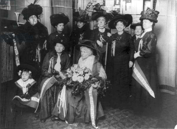 WOODHULL & CLAFLIN, 1922 Seated front row: Victoria Claflin Woodhull and Tennessee Celeste Claflin, American women's rights activists, photographed surrounded by fellow suffragettes, 1922.