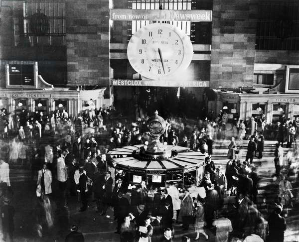 NEW YORK: BLACKOUT, 1965 Commuters spending the night at Grand Central Terminal during the Northeast Blackout, 9 November 1965. The large electrical clock stopped when power failed, the old clock below indicates the correct time.