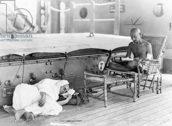 MOHANDAS GANDHI (1869-1948) Hindu nationalist and spiritual leader. Photographed on board the SS Rajputana with Madeline Slade, 1931.