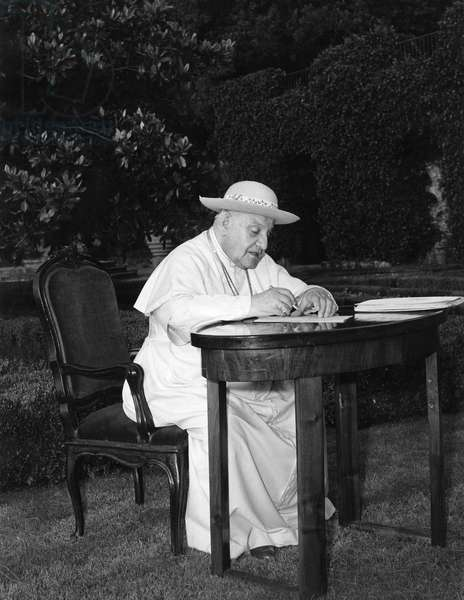 JOHN XXIII (1881-1963) Pope, 1958-1963. Photographed writing at a desk, while on vacation at the papal summer palace in Castel Gandolfo, Italy, 1961.