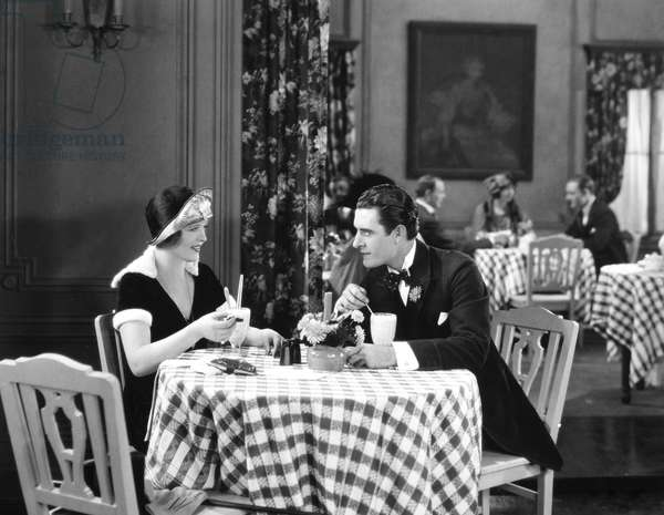 THE SNOB, 1924 Phyllis Haver and John Gilbert in a scene from the film.