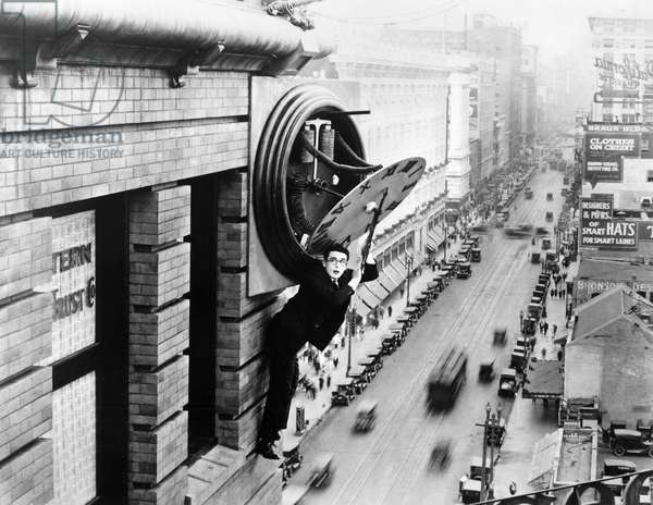 FILM: SAFETY LAST! Harold Lloyd hanging from the clock in the film 'Safety Last!,' 1923. EDITORIAL USE ONLY.
