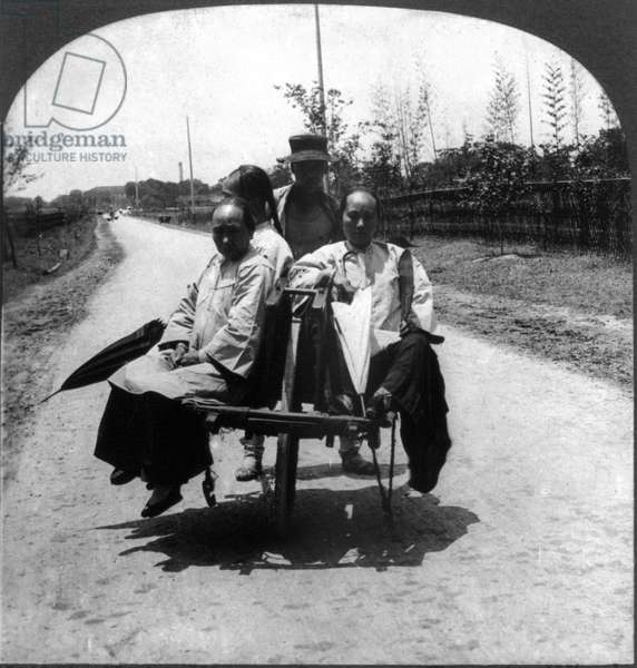 CHINA: WHEELBARROWS, c.1926. Upper class Chinese women traveling to town in a wheelbarrow pushed by one man, China. Stereograph, c.1926.