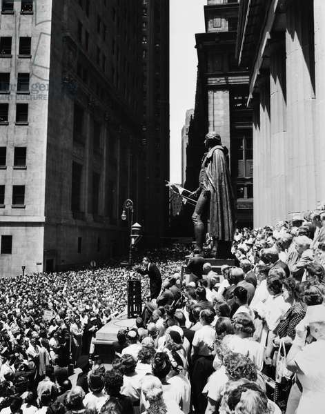 BILLY GRAHAM (1918- ) William Franklin Graham. American evangelist. Graham giving a speech before a large crowd on Wall Street in New York City, July 1957.