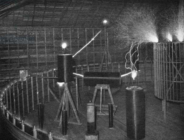 TESLA'S LABORATORY, c.1900 Coils responding to electrical oscillations during a demonstration in Nikola Tesla's laboratory in Colorado Springs, Colorado. Photograph by Dickenson V. Alley, c.1900.
