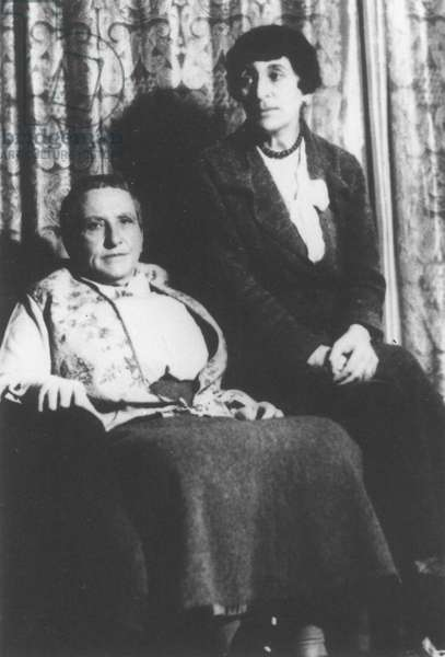 STEIN AND TOKLAS Gertrude Stein (1874-1946), at left, with her companion, Alice B. Toklas (1877-1967): photograph, n.d.
