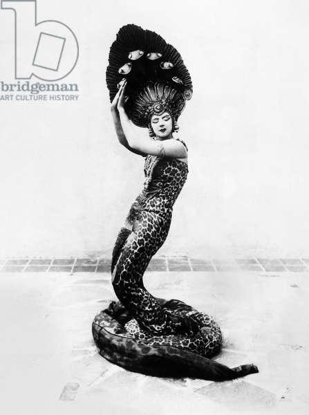 RUTH ST. DENIS (1879-1968) American dancer and choreographer. Performing the Peacock Dance, c.1920 (b/w photo)