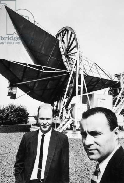 WILSON AND PENZIAS, 1965 American astronomer Robert W. Wilson (left) and American physicist Arno Penzias standing in front of the horn-reflector antenna on Crawford Hill in Holmdel Township, New Jersey, which they had used in conducting their research into cosmic microwave background radiation that corroborated the Big Bang theory. Photographed in 1965.