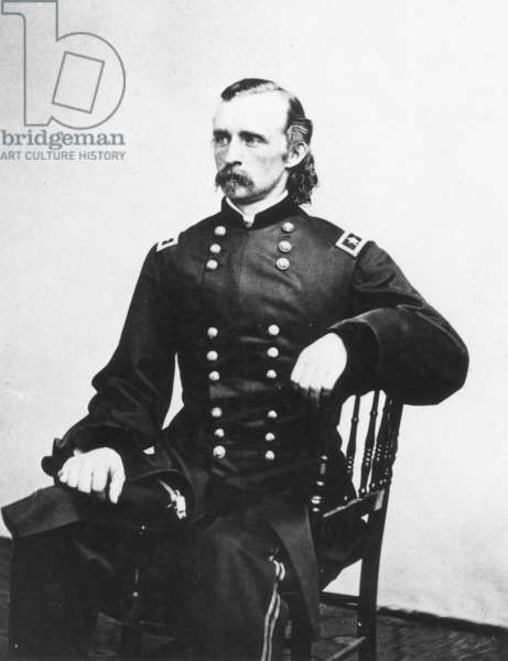 GEORGE CUSTER (1839-1876) American army officer. Photographed in 1865 in the uniform of a major general by Mathew Brady.
