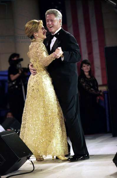THE CLINTONS, 1997 President Bill Clinton and First Lady Hillary Rodham Clinton dancing at Clinton's Inaugural Ball in Washington, D.C. Photograph, 1997.