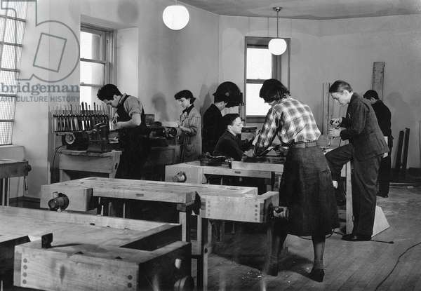 CHICAGO: NEW BAUHAUS Men and women in a workshop of the New Bauhaus in Chicago, Illinois. Photograph, c.1940.