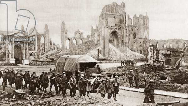 WORLD WAR I: PRISONERS German prisoners-of-war marching through the city of Ypres after the Battle of the Menin Road, the ruins of the Cloth Hall are in the background. Photograph, September 1917.