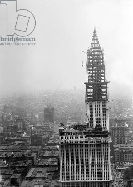 WOOLWORTH BUILDING, 1912 Tower construction for the Woolworth Building on lower Broadway, New York City, which was completed in April 1913. On the right is the Municiple Building, also under construction. Photograph, c.1912.