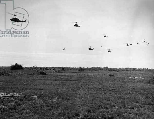 VIETNAM WAR: HELICOPTERS U.S. Army Bell Huey helicopters prepare to land near Trang Bang, South Vietnam, November 1964.
