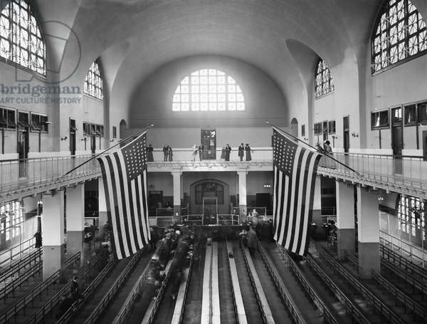 ELLIS ISLAND: GREAT HALL The 'Great Hall' at the immigration station in New York Harbor, where medical inspectors checked the arrivals. Photograph, c.1910.