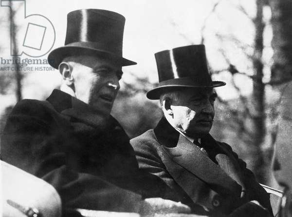 WOODROW WILSON (1856-1924) 28th President of the United States. Wilson riding with President-elect Warren G. Harding to the latter's inauguration at the U.S. Capitol, Washington, D.C., 4 March 1921.