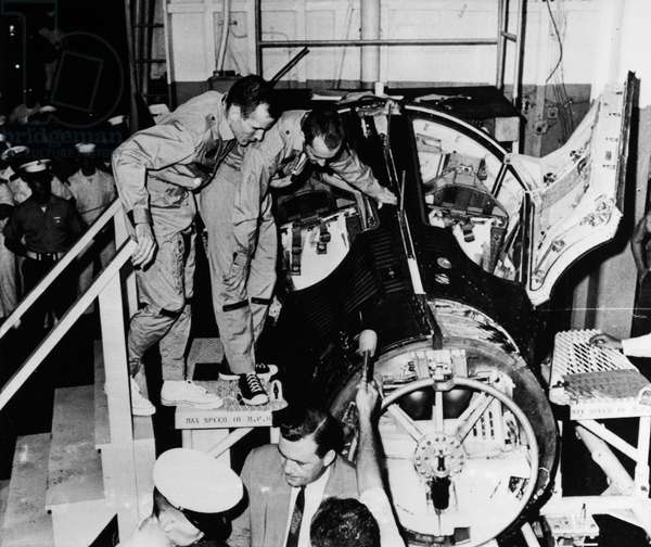 GEMINI 4: ASTRONAUTS, 1965 Astronauts Edward White and James McDivitt examining their capsule after landing, 1965.
