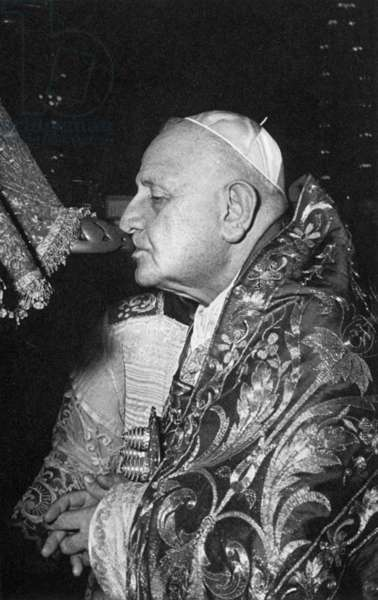 JOHN XXIII (1881-1963) Pope, 1958-1963. Kissing the foot of the statue of St. Peter on 28 June 1960, the eve of the feast day of the apostle, when the statue is robed in rich vestements.