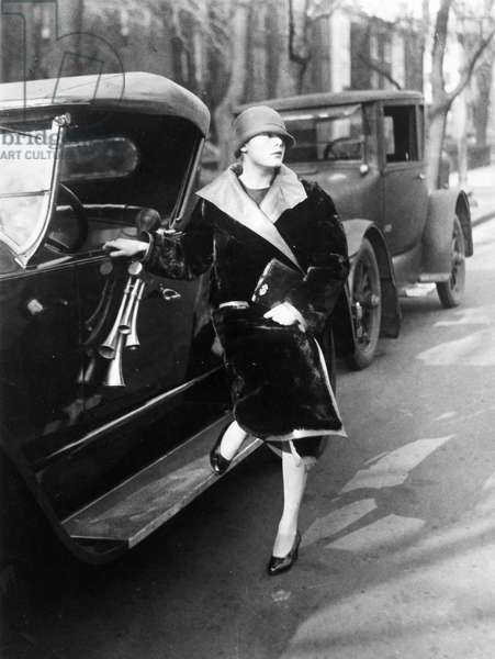FLAPPER, 1926 Suzette Dewey, daughter of Assistant Secretary to the Treasury Charles Dewey, beside her roadster, Washington, D.C., 1926.
