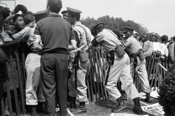 MARCH ON WASHINGTON, 1963 Police attempt to keep Civil Rights demonstrators behind a storm fence at the March on Washington, D.C. Photographed by Marion Trikosko, 28 August 1963.