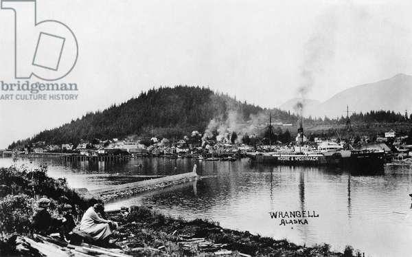 ALASKA: WRANGELL The city of Wrangell, Alaska along the Stikine River. Photo postcard, late 19th or early 20th century.