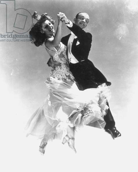 HAYWORTH & ASTAIRE Rita Hayworth dancing with Fred Astaire, in a publicity still from the early 1940s.