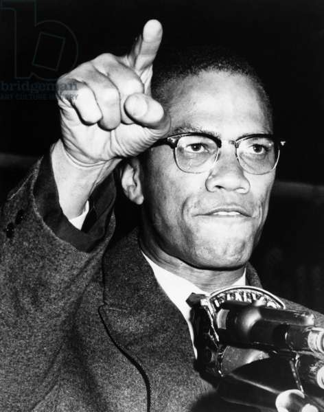 MALCOLM X (1925-1965) Born Malcolm Little. American religious and political leader. Photographed while giving a speech at a rally in Harlem, New York City, c.1963.