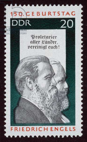 ENGELS AND MARX Friedrich Engels (1820-1895), foreground, and Karl Marx (1818-1883). German political philosophers. On an East German postage stamp, 1970.