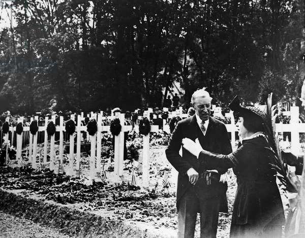WOODROW WILSON (1856-1924) 28th President of the United States. President Wilson talking with the widow of an American soldier at a military cemetary in France on Decoration Day, 1919.