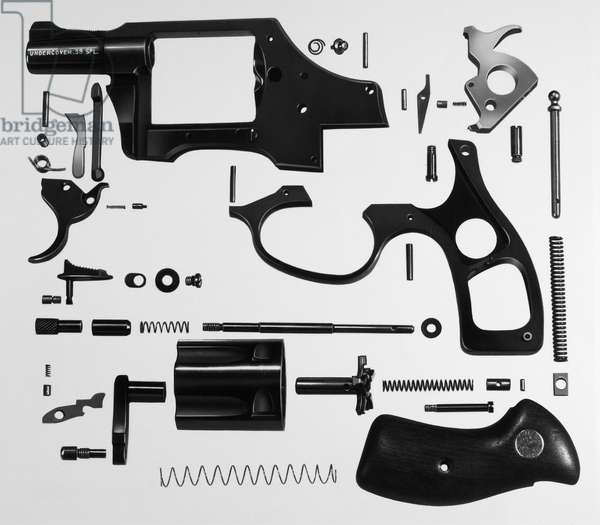 CHARTER ARMS REVOLVER A disassembled Charter Arms Undercover .38 caliber revolver.