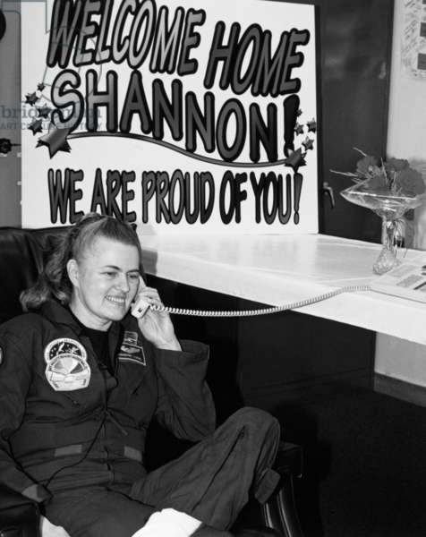 SHANNON LUCID (1943- ) American astronaut. Photographed on the telephone with President Bill Clinton, after her record-setting 188 day spaceflight, 1996.