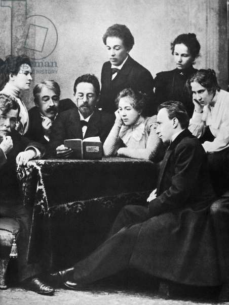 ANTON CHEKHOV (1860-1904) Anton Pavlovich Chekhov. Russian writer. Chekhov (center, with book) photographed in 1898, flanked by Konstantin Stanislavsky and Olga Knipper-Chekhova, with members of the Moscow Art Theatre.