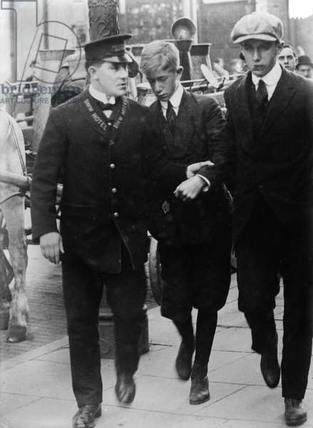 LUSITANIA VICTIMS, 1915 Two brothers rescued from the wreck of the Cunard steamship 'Lusitania,' which was sunk by German torpedos near the Irish coast, 7 May 1915. Photographed on 24 May 1915.