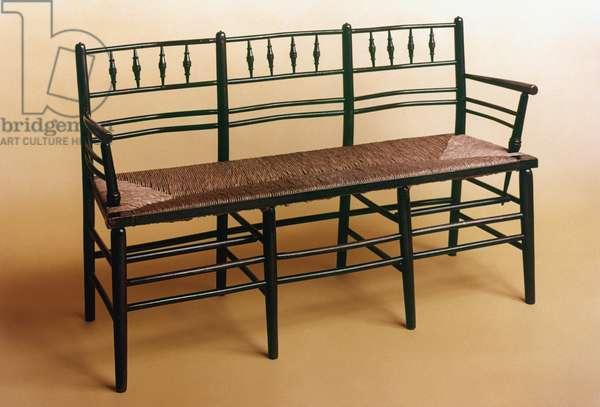 WILLIAM MORRIS SETTEE The 'Sussex' rush-seated settee designed by William Morris, c.1875.