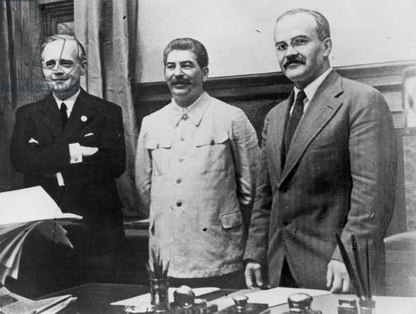 NAZI-SOVIET PACT, 1939 Joachim von Ribbentrop (left), German Minister for Foreign Affairs, Joseph Stalin (center), and Soviet Foreign Minister Vyacheslav Molotov (right), photographed in Moscow after the signing of the Nazi-Soviet non-aggression pact, 23 August 1939.
