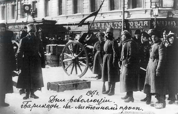 RUSSIAN REVOLUTION, 1917 People in front of a barricade on a street in the Liteinyi Prospect in Petrograd, Russia, 1917.