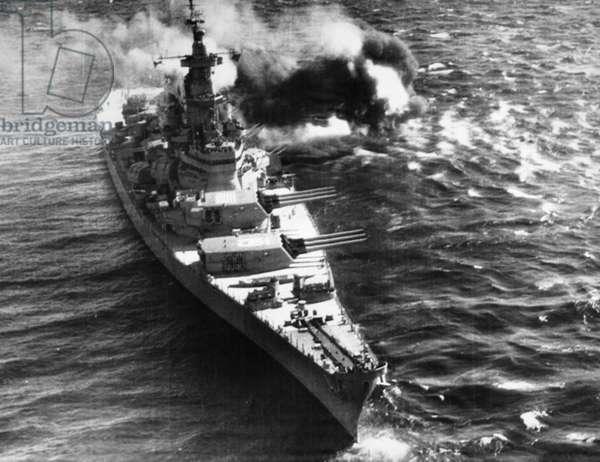 KOREAN WAR: BATTLESHIP The U.S.S. 'Iowa' fires on targets off the coast of North Korea, late 1952.