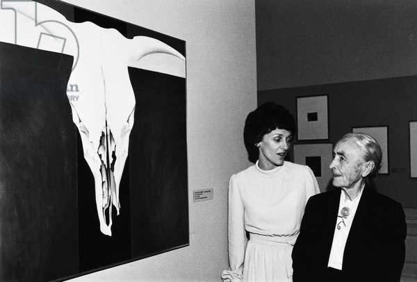 GEORGIA O'KEEFFE (1887-1986) American painter. O'Keeffe (right) in front of one of her paintings with Joan Mondale (wife of Vice President Walter Mondale) at the National Gallery of Art, Washington, D.C., 1977.