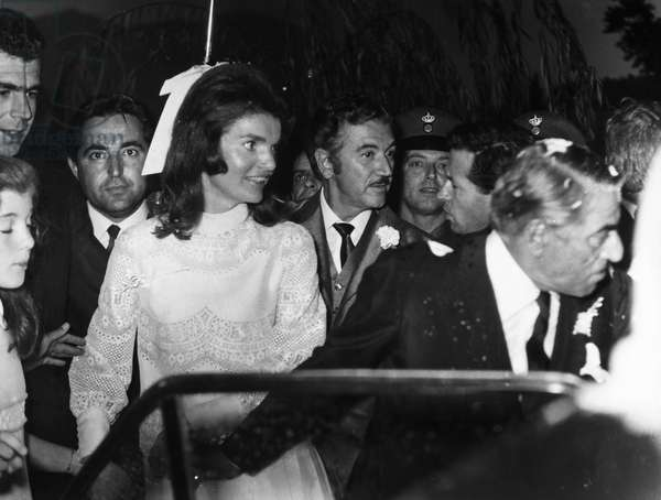 JACQUELINE KENNEDY ONASSIS (1929-1994). Wife of U.S. President John Fitzgerald Kennedy and Greek shipping magnate Aristotle Onassis. Photographed with Aristotle Onassis (right foreground) following their wedding on Skorpios, Onassis' private island in the Ionian Sea off the west coast of Greece, 20 October 1968.