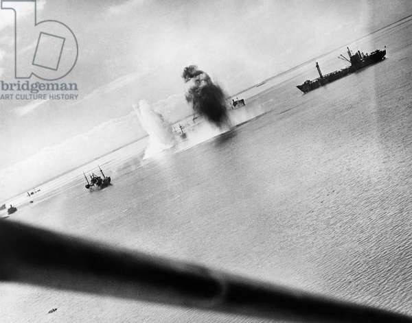WWII: NAVAL BATTLE, 1944 Japanese ships under attack by U.S. Navy planes in Manila Bay, Philippines. Photograph, 25 November 1944.