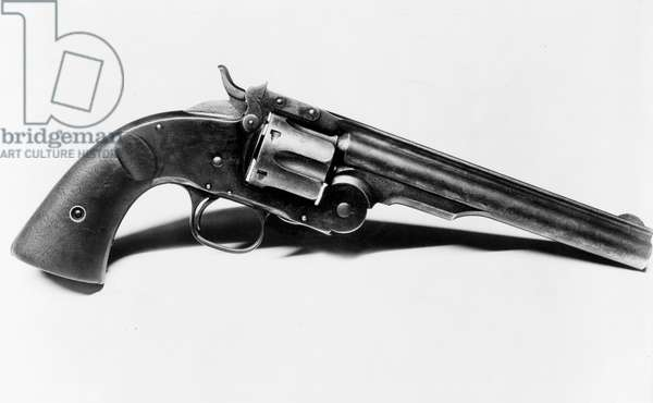 JESSE JAMES (1847-1882) A .45 Schofield revolver, the last gun used by Jesse James. Photograph, c.1921.